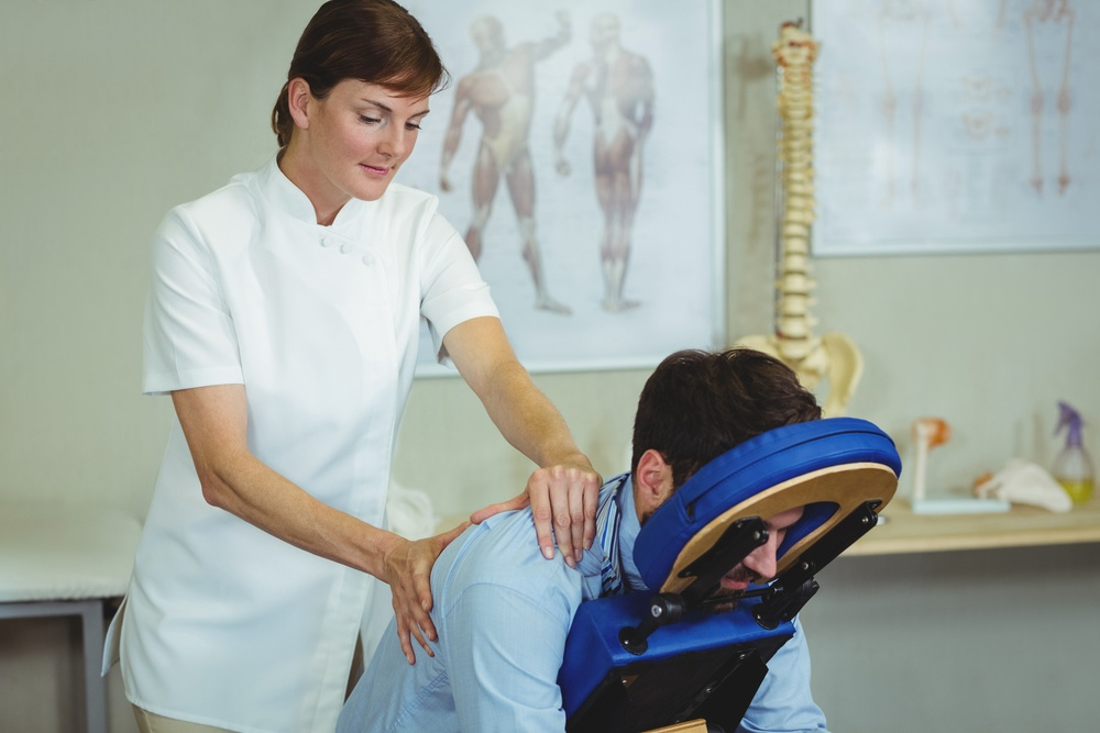 physical therapist helping with chronic back pain relief