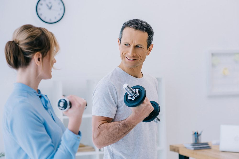Ferrell Whited trainer working with patient on personal training